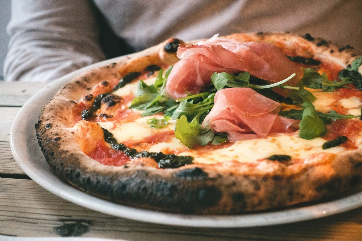 Neapolitan pizza with prosciutto crudo