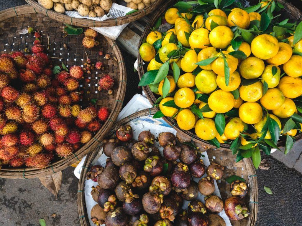 Baskets of rambutan, mangosteen and tangerines