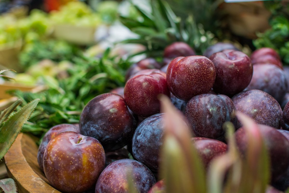 Fresh plums at a farmers market