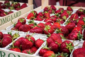 Fresh strawberries in paper boxes
