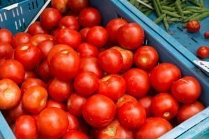 Vibrant red tomatoes on a market