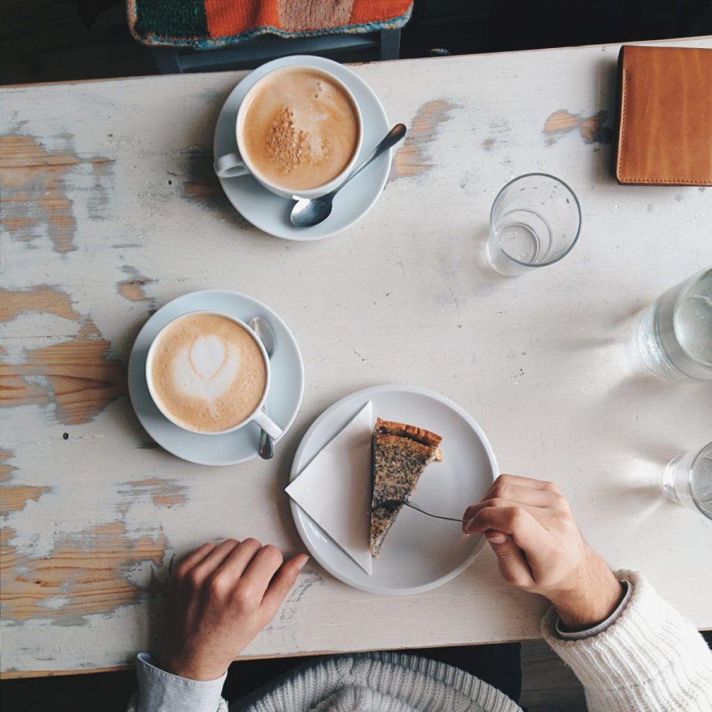 White and brown coffee with cake scene