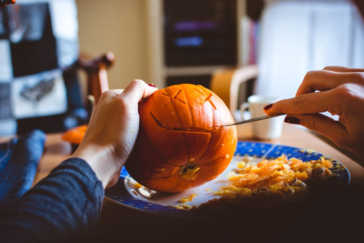 Carving Halloween pumpkin