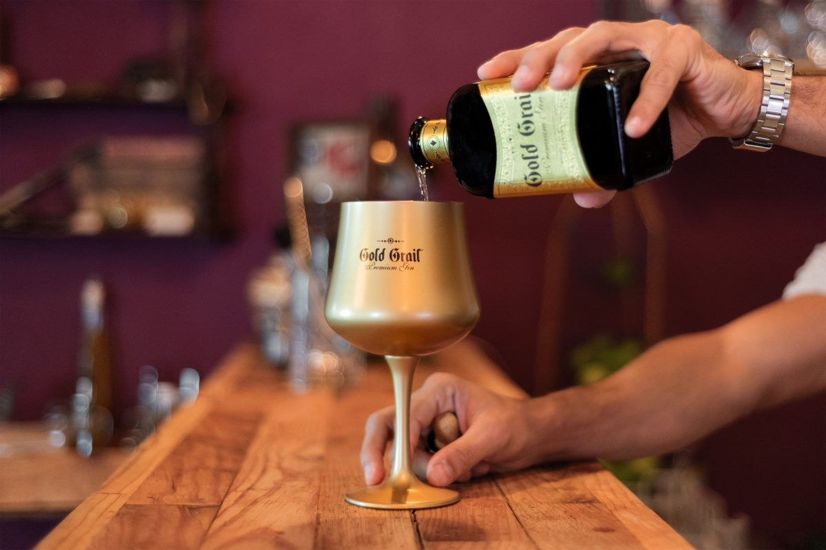 Barman pouring liqueur
