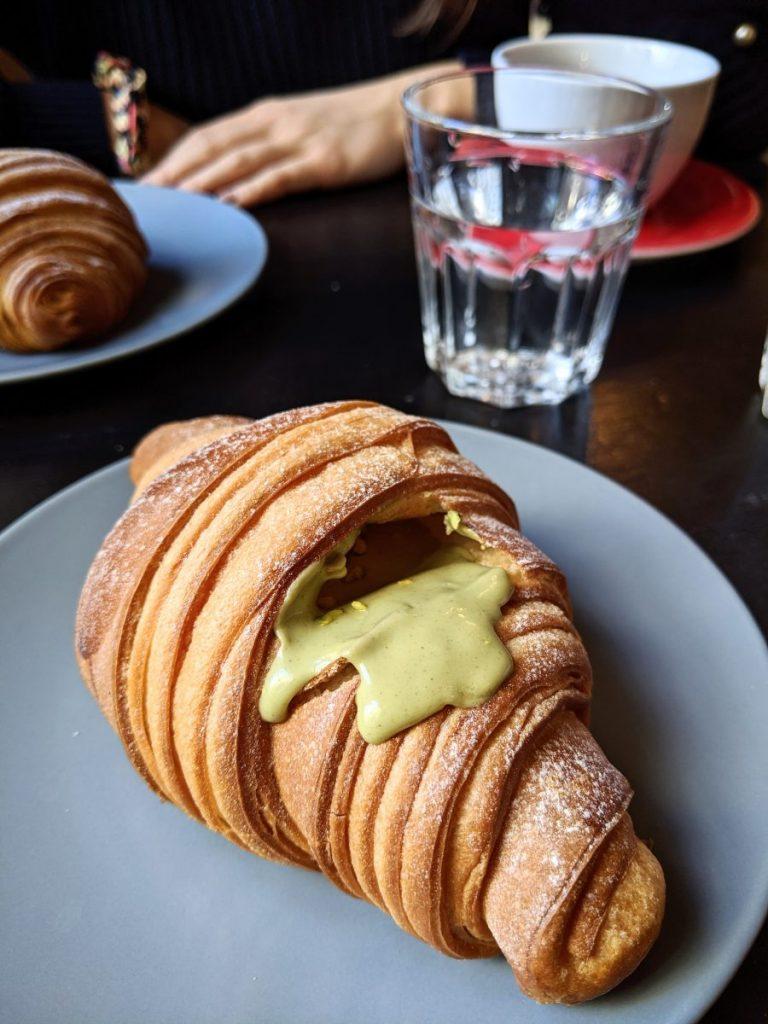 Pistachio croissant in a coffeeshop