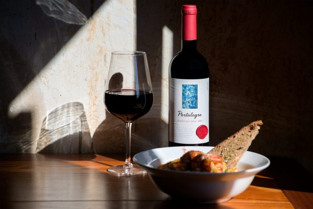 Glass of red wine with light lunch