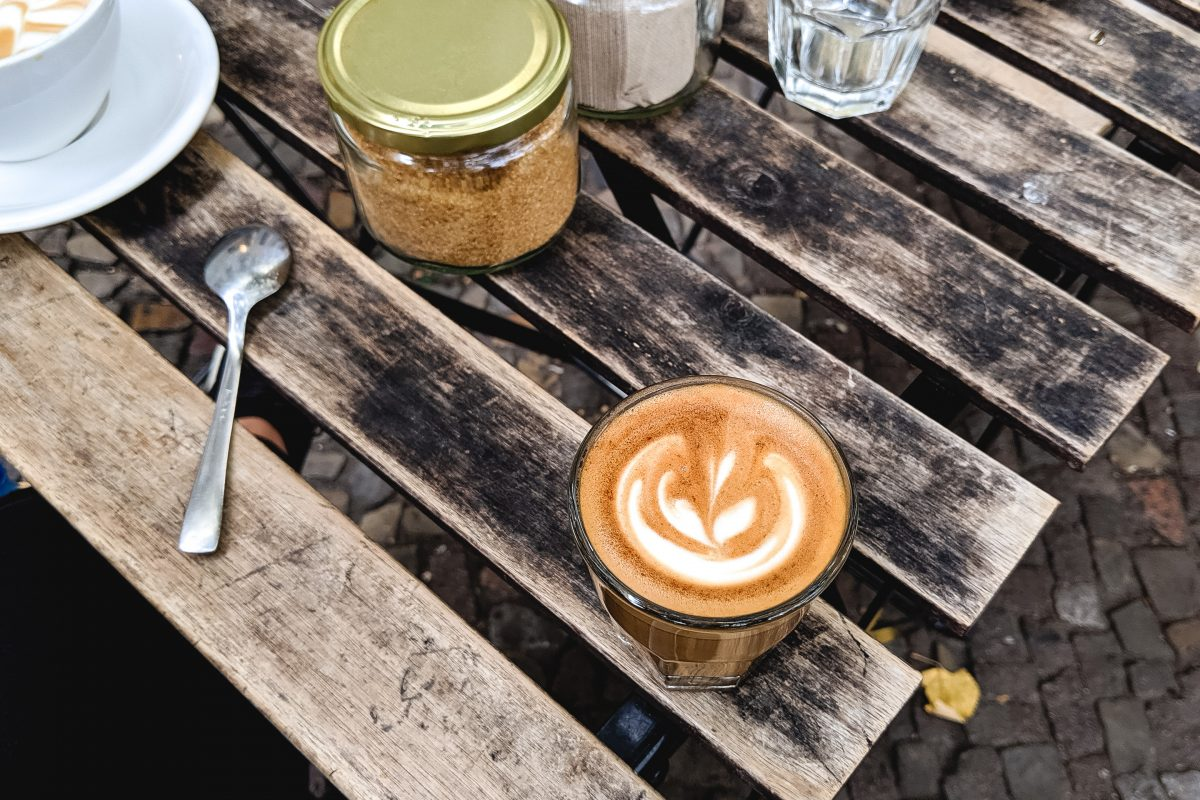 Cappuccino outside on a wooden table