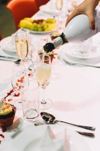 Pouring a toast of champagne on a wedding celebration party
