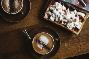 Two coffee cappuccino and waffle