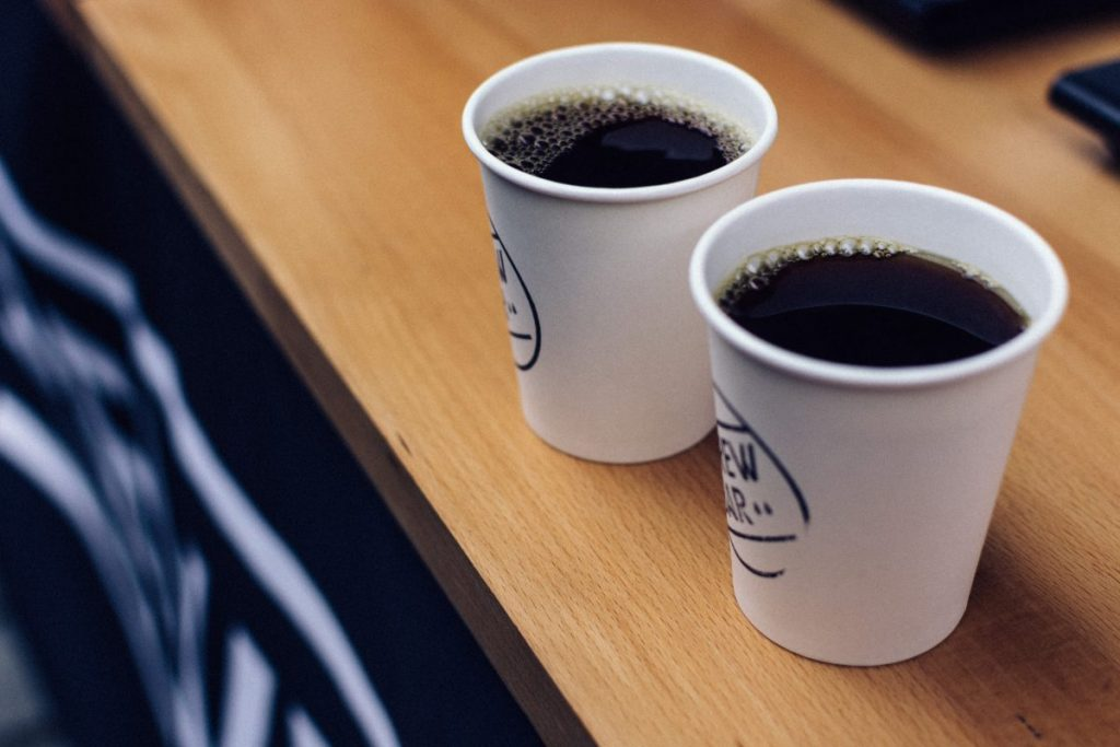 Two takeaway cups of filtered coffee