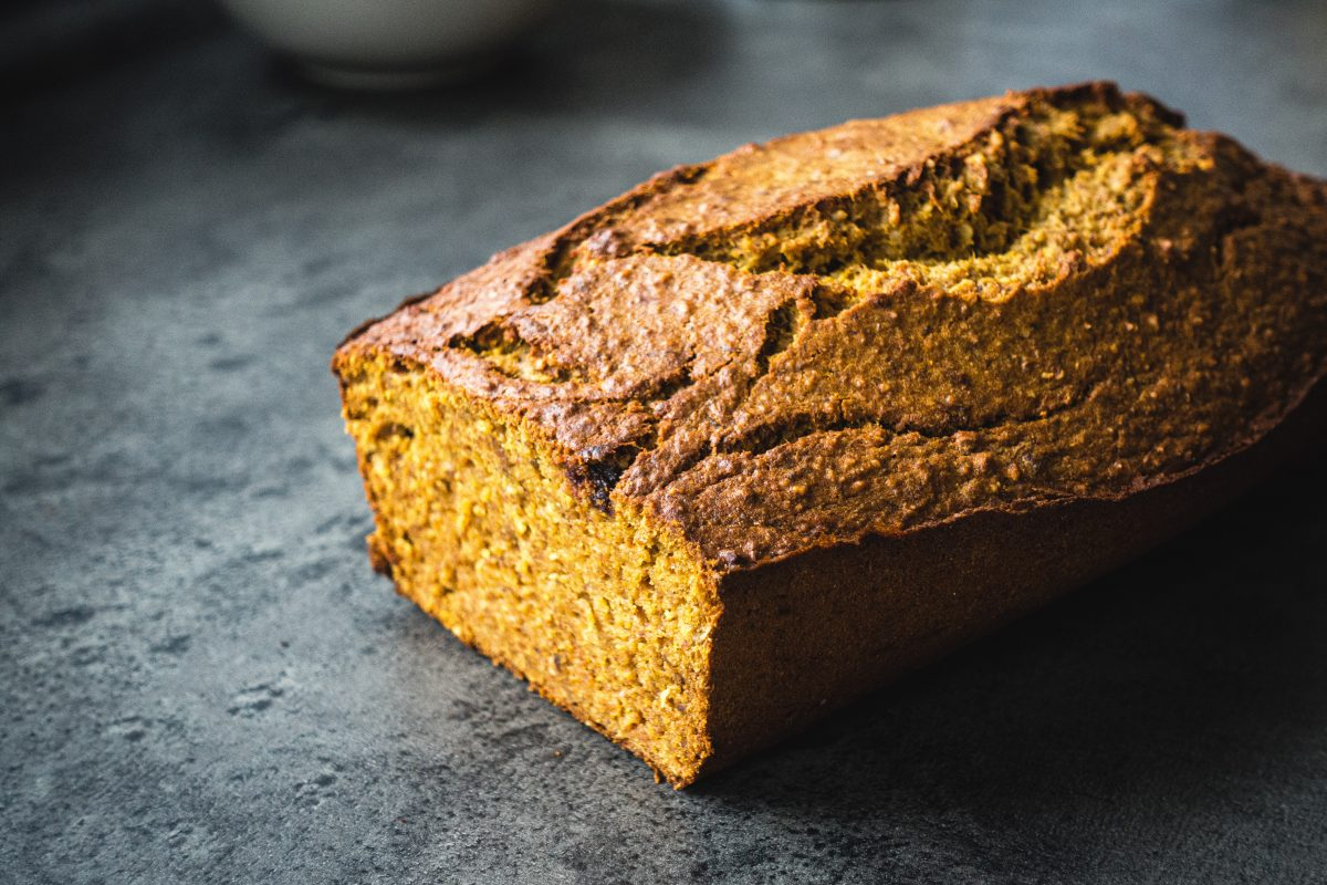 Yellow homemade banana bread with curcuma