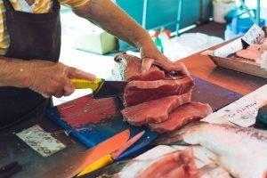 Portioning tuna at fish market
