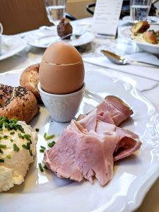 Soft boiled egg with ham for breakfast