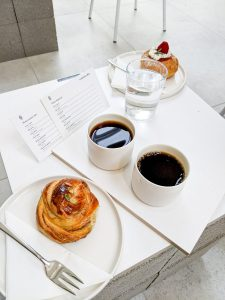 Coffee break with small sweet pastry