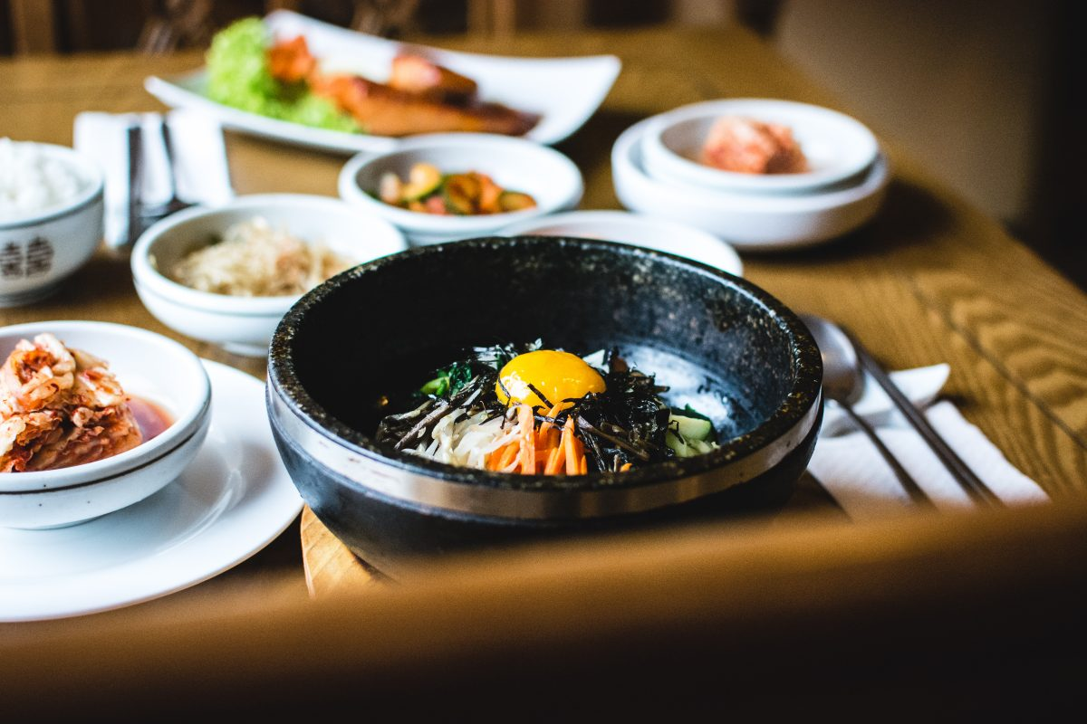 Traditional Korean Bibimbap vegetables with raw egg yolk