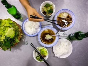 Eating delicious Vietnamese Bun Cha noodles with pork