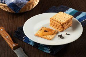 Cream cracker biscuit with apple jam