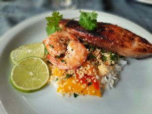 Vegetable couscous with shrimps and fish