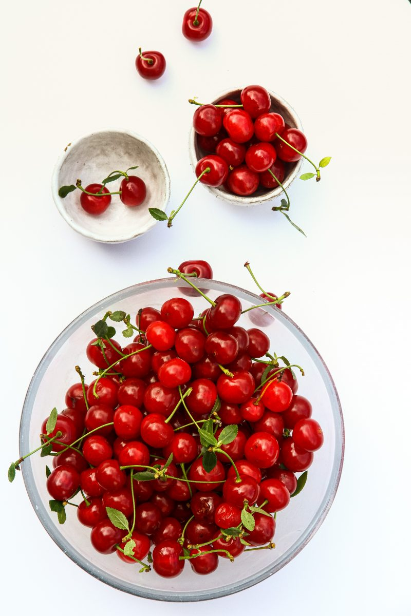Freshly picked cherries on a white background