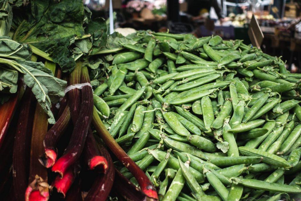 Fresh peas and rhubarb at market