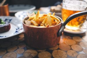 French fries with steak and beer