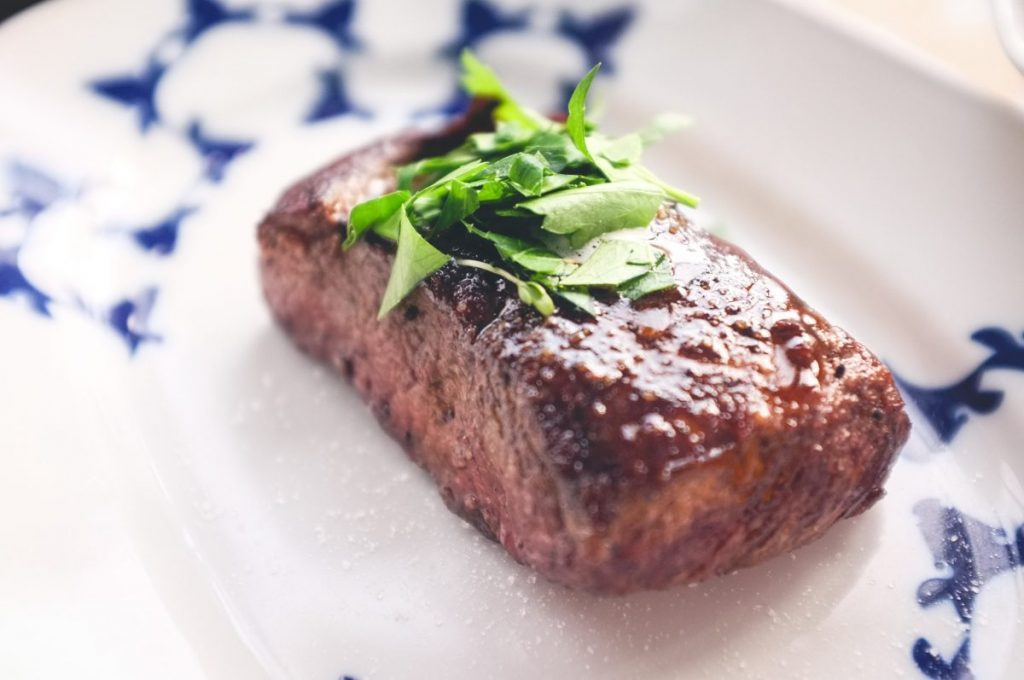 Grilled beef steak with herbs