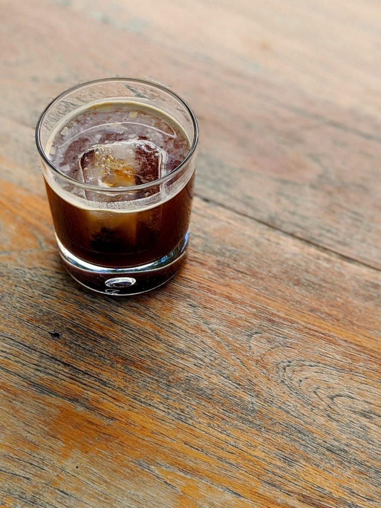 Cold coffee americano on rocks
