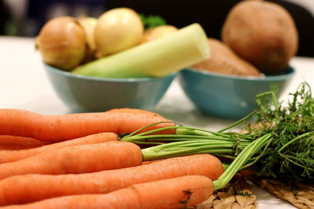 Carrot close up with other vegetables for soup