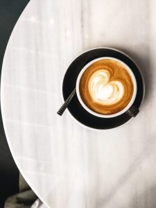 Coffee with milk with hearty latté art