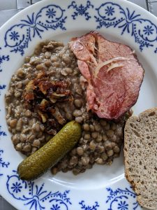 Traditional lentil stew with smoked pork meat