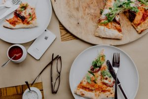 Slice of pizza with rocket leaf