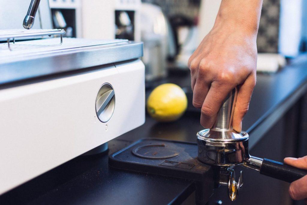 Pressing coffee in portafilter