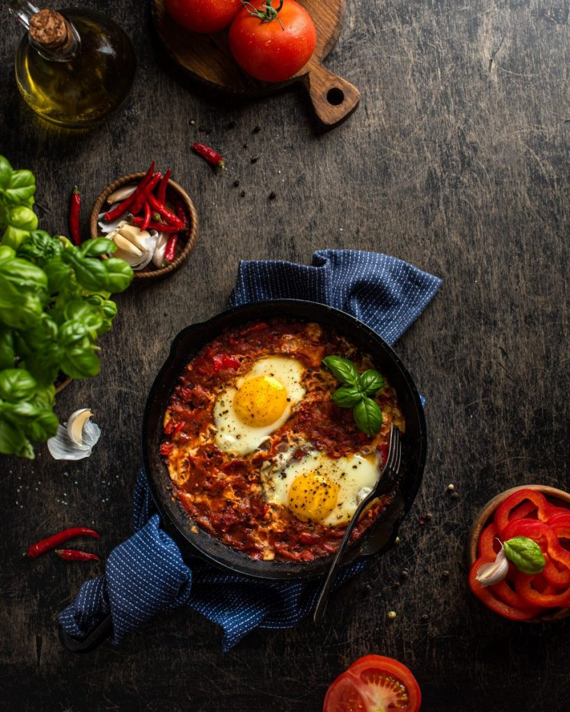 Hot shakshuka in a cast iron pan