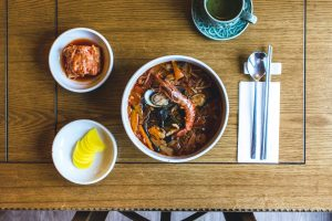 Korean spicy seafood soup with king prawns from top view