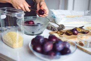 Preparing plums for baking