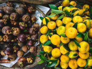 Tangerines and mangosteen at a market