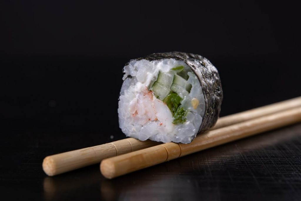 Sushi maki roll with black background