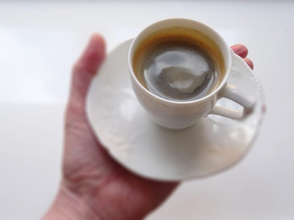 Cup of espresso in a hand