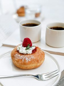 Small donut with raspberry on top