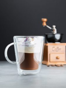 Coffee in a glass cup with foam